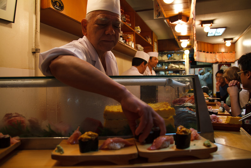 We finally get our seats and order 'omakase'. This means the chef gives you whatever he feels like preparing.